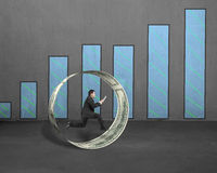Businessman using tablet running inside money circle with chart Stock Images