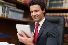 Businessman using a tablet Stock Photography