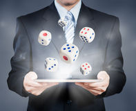 Businessman using tablet showing dice Stock Photos