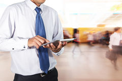 Businessman using tablet Stock Images