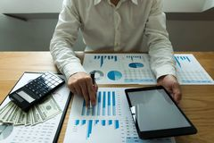 Businessman using tablet to the situation on the market value , stock images