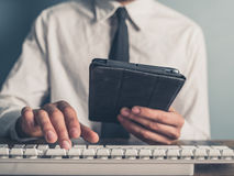 Businessman using tablet and typing on keyboard Stock Images