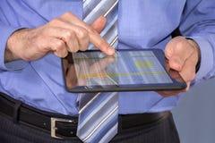 Businessman using tablet Stock Image