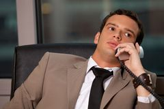 Businessman using telephone Royalty Free Stock Photos
