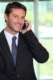 Businessman using a telephone Royalty Free Stock Photo