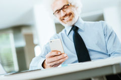 Businessman using a touch screen phone Stock Photo