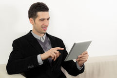 Businessman Using A Touch Screen Tablet Royalty Free Stock Images