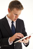 Businessman using touch screen tablet computer. Young businessman using touch screen tablet computer Stock Photos