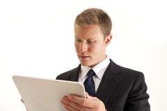 Businessman using touch screen tablet computer. Young businessman using touch screen tablet computer Royalty Free Stock Photo