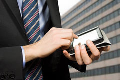 Businessman using a touchscreen device Royalty Free Stock Photography