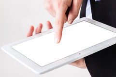Businessman using touchscreen Stock Images