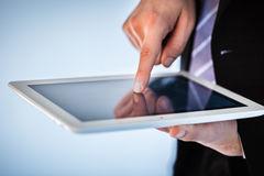 Businessman using touchscreen on tablet Royalty Free Stock Photos