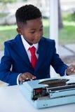 Businessman using typewriter Stock Image