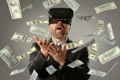 Businessman Using Virtual Reality Getting Money Royalty Free Stock Image