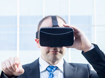 Businessman using virtual reality glasses in a business center. New technology for business concept Royalty Free Stock Photography