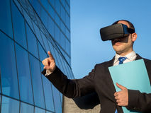 Businessman using virtual reality glasses for a meeting in cyber Stock Photo