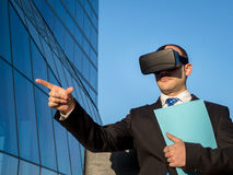 Businessman using virtual reality glasses for a meeting in cyber Stock Image