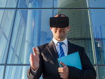 Businessman using virtual reality glasses for a meeting in cyber Royalty Free Stock Image