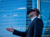 Businessman using virtual reality glasses for a meeting in cyber Stock Images