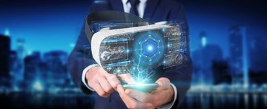 Businessman using virtual reality glasses technology 3D renderin. Businessman on blurred background using virtual reality glasses technology 3D rendering Royalty Free Stock Images