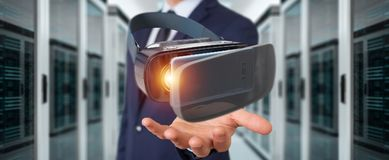 Businessman using virtual reality glasses technology 3D renderin. Businessman on blurred background using virtual reality glasses technology 3D rendering Stock Image
