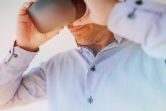 Businessman using the virtual reality headset Royalty Free Stock Photos