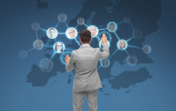 Businessman using virtual screen with contacts Royalty Free Stock Photos