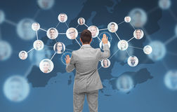 Businessman using virtual screen with contacts Royalty Free Stock Photo