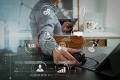 Businessman using VOIP headset with digital tablet computer and. Business process management with workflow automation diagram and gears in virtual flowchart Stock Photos