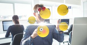 Businessman using VR while touching various emojis. Digital composite of Businessman using VR while touching various emojis Stock Photos