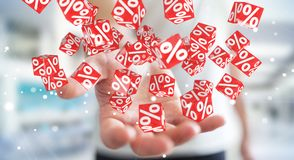 Businessman using white and red sales flying icons 3D rendering. Businessman on blurred background using white and red sales flying icons 3D rendering Royalty Free Stock Photo