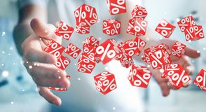 Businessman using white and red sales flying icons 3D rendering. Businessman on blurred background using white and red sales flying icons 3D rendering Stock Image