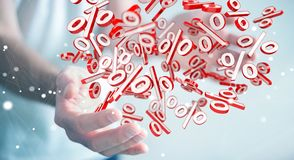 Businessman using white and red sales flying icons 3D rendering. Businessman on blurred background using white and red sales flying icons 3D rendering Stock Photo