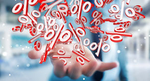 Businessman using white and red sales flying icons 3D rendering Stock Images
