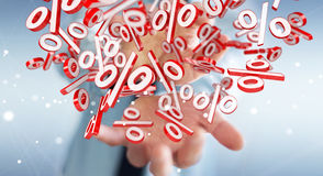 Businessman using white and red sales flying icons 3D rendering. Businessman on blurred background using white and red sales flying icons 3D rendering Royalty Free Stock Photos