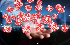 Businessman using white and red sales flying icons 3D rendering. Businessman on blurred background using white and red sales flying icons 3D rendering Royalty Free Stock Image