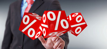 Businessman using white and red sales flying icons 3D rendering Stock Photo