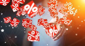 Businessman using white and red sales flying icons 3D rendering Royalty Free Stock Photography
