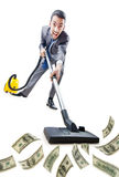 Businessman with vacuum cleaner Stock Photo