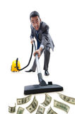 Businessman with vacuum cleaner Royalty Free Stock Photo