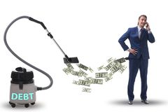 Businessman and vacuum cleaner sucking money out of him royalty free stock image