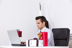 Businessman with valentine day presents Stock Photography