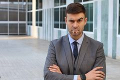 Businessman with vampire fangs in the office stock photo