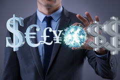 The businessman with various currencies in business concept Stock Images