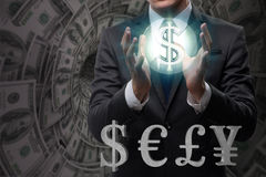 The businessman with various currencies in business concept Royalty Free Stock Images
