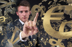 The businessman with various currencies in business concept Stock Photos