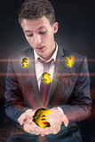 The businessman with various currencies in business concept Stock Photo