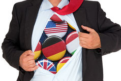 Businessman with various nationalities. A businessman with international flags on buttons inside his shirt - an international business, international trade or Royalty Free Stock Photos