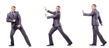 The businessman in various poses isolated on white Stock Photos