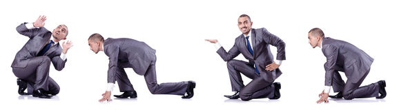 The businessman in various poses isolated on white Royalty Free Stock Photo
